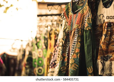 African dress hanging in an African outdoor market