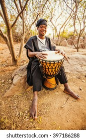 african drummer playing