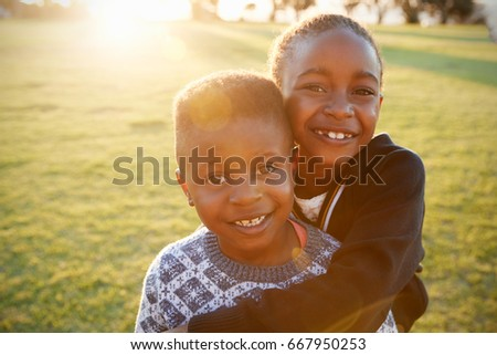african elementary school boy girl hugging stock photo edit now