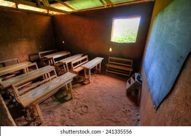 African Elementary School Classroom in a clay building with dirt floors.