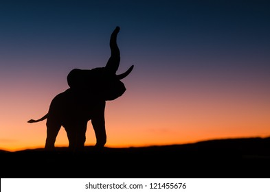 African elephant silhouette trumpeting in sunset in the wild