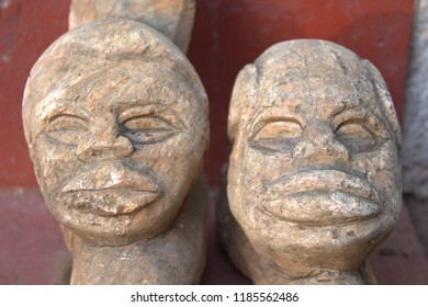 African faces carved from stone
