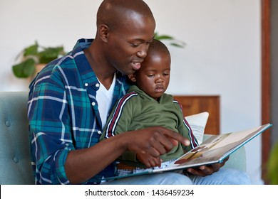 African family dad reading to son stories, story telling time love closeness