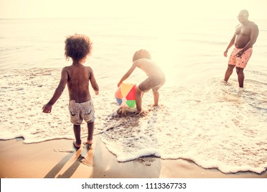 African family enjoying the beach