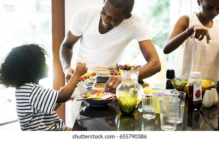 African family preparing barbecue in the kitchen together