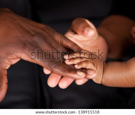 An african family's hands coming together