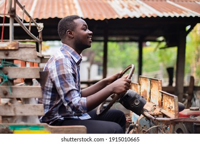African farmer man drive small tractor in the countryside