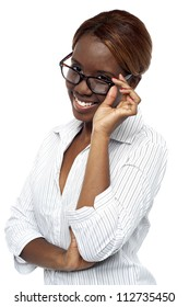 African female executive adjusting her spectacle. Looking at camera and smiling