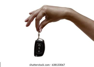 African female hand holds car keys on white background.