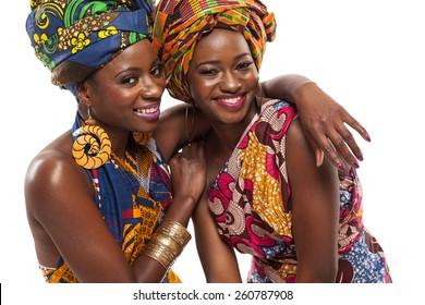 African female models posing in colorful dresses.