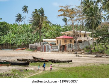 African Fishermen Village by the sea in Sao Tome and Principe near mountains like Pico Cao Grande. Travel to Sao Tome and Principe to see a beautiful paradise island in Gulf of Guinea in Africa