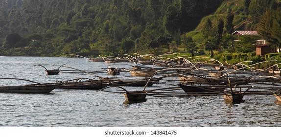 African fishing boats floating off shore in Kibuye, Rwanda, Africa