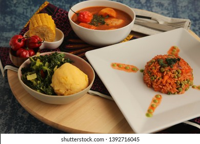 African Food on Plate- Chicken Stew,Ugali,Jollof Rice and Green Salad with Red Bell Pepper and Corn