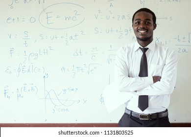 African foreign teacher teaching  science in the classroom.