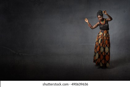 african girl dancing, dark background