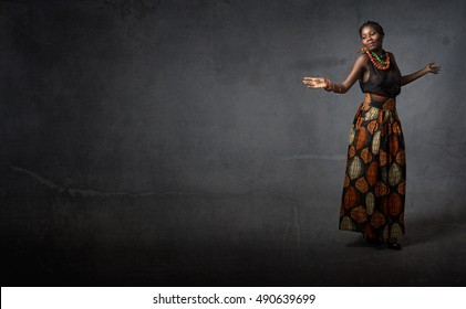 african girl dancing wiht open hands, dark background