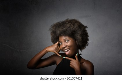 african girl happy on phone, dark background