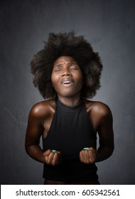 african girl pleasure face, dark background