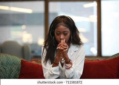 African girl praying, office, customer service, earphone, call center telemarketer, technical support hotline