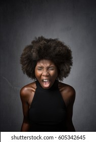 african girl scream and mad, dark background