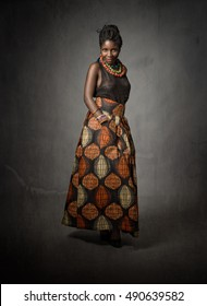 african girl standing on dark background