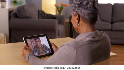 African grandma video chatting on tablet