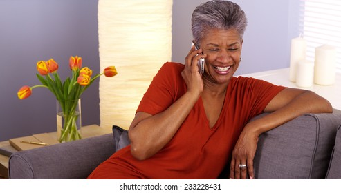 African grandmother talking on smartphone