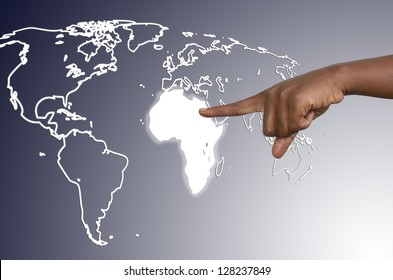 African hand touching map of africa on virtual touchscreen, studio shot