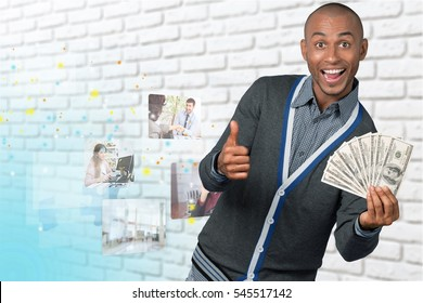 African holding thumbs up and money.