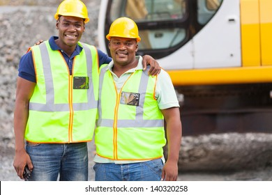 african industrial co-workers portrait in front of machine