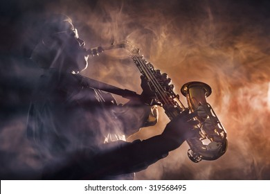 African jazz musician playing the saxophone. Orange color