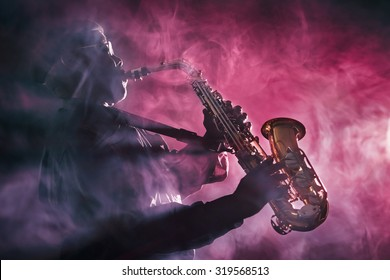 African jazz musician playing the saxophone. Red Color