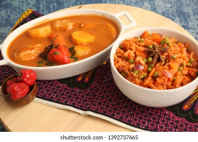African Jollof Rice and Chicken Stew Dish with Red Bell Pepper on Side