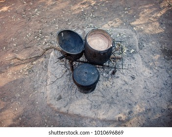 African kitchen cooking porridge in the back of the house in the village, Botswana