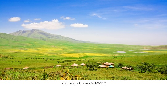 African landscape with blue sky and white clouds between Ngorongoro Crater and the Serengeti National Park, Tanzania