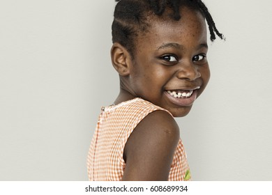 African little girl turn back and smiling studio portrait