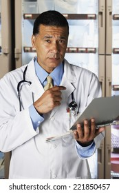 African male doctor holding chart