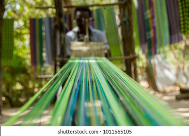 An african male shows traditional weaving in Makasutu forest, The Gambia, Africa