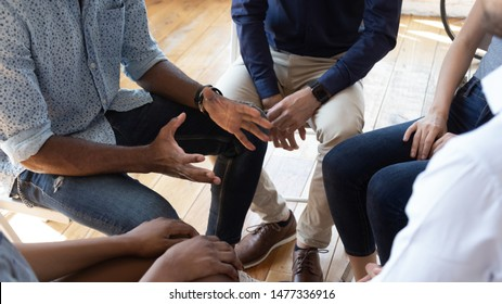African man counselor therapist coach psychologist speak at group counseling therapy session concept encourage support patients in addiction talk share problem sit in circle in rehab, close up view