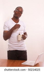 African man with cup of tea