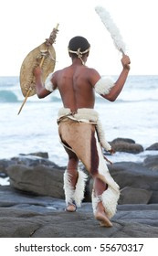 african man dressing in traditional clothes on beach