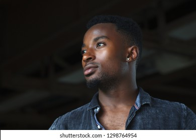 african man earring dark lighting portrait