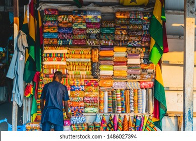 African man with fabric in market