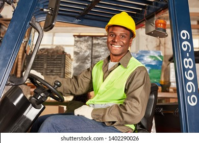 African man as a forklift driver in training in the logistics center
