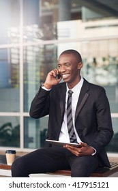 African man with a friendly smile talking on his phone