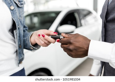 African man gives the girl the keys to a new car close-up