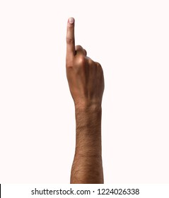 African man hand showing forefinger up tossing a coin isolated on white