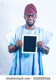 African man holding a tablet device showing copy space