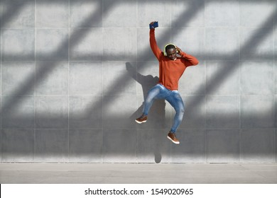 African Man Jumping For Joy Listening To Music