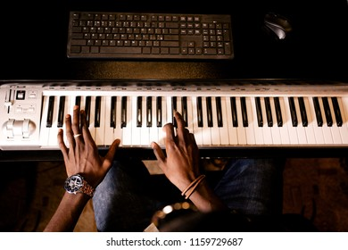 African man plays jazz on musical synthesizer